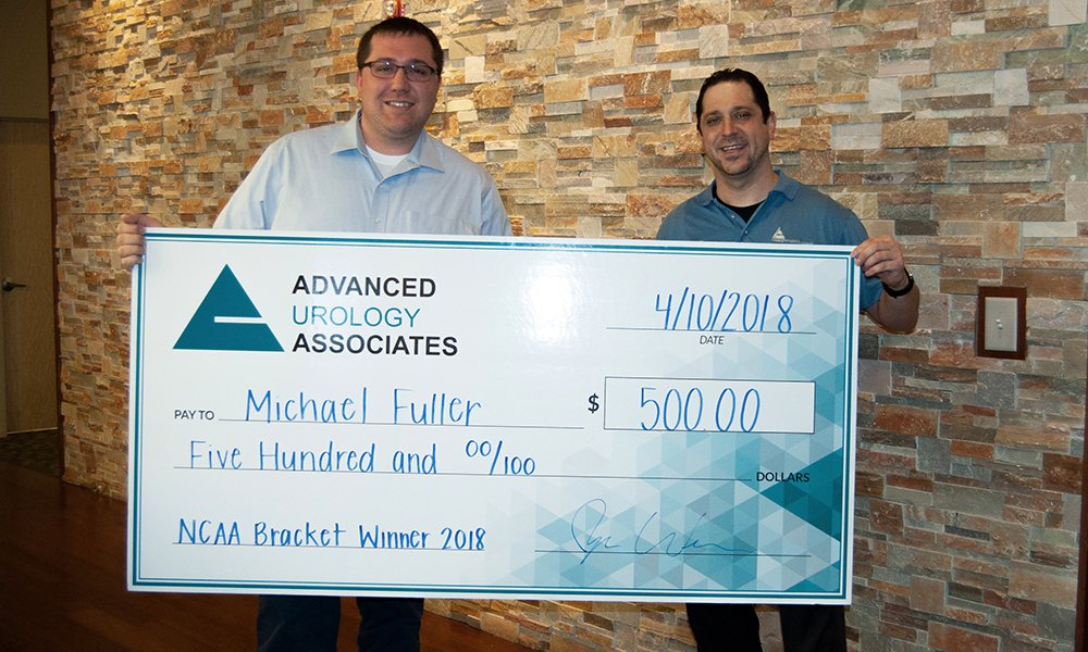 Ryan Weber presents check for winner Michael Fuller for the Advanced Urology's 2018 VasecTourney!